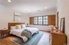 Another bedroom has a warm, inviting design.