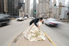 Couple in focus, traffic zooming by on Michigan Ave