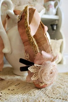 altered fairy slipper by Sugah Beez, via Flickr (I could do this with the children's extra ballet slippers)