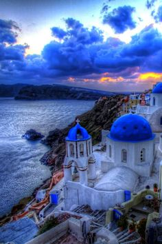 Blue hour in Oia, Santorini. Our tips for 25 Fun Places to Visit in Greece… Places Around The World, Oh The Places You'll Go, Places To Travel, Travel Destinations, Dream Vacations, Vacation Spots, Oia Santorini Greece, Santorini Travel, Akrotiri Santorini