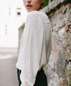 textured cream blouse