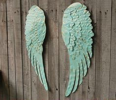 Romantic set of large hand painted metal angel wings. Done in very soft aqua and accented in gold with a protective coating. They each have 3 sawtooth hangers on the back and can be hung several diffe