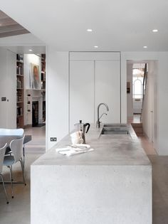 I loved loved loved our concrete countertops in the big house. Next house we have I'll get them again! Concrete kitchen island in modern addition to London townhouse gray and white palette Classic Kitchen, Stylish Kitchen, New Kitchen, Kitchen Island With Sink, Space Kitchen, Kitchen Walls, Basement Kitchen, Kitchen Cupboard, Kitchen White