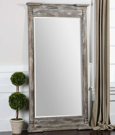 """Valcellina Item #07652 Share on facebookShare on twitterShare on emailMore Sharing Services Frame is made of weathered wood covered in a distressed ivory gray finish. Mirror features a generous 1 1/4"""" bevel. May be hung horizontal or vertical.  Designer:NA Dimensions:38 W X 74 H X 5 D (in) Weight (lbs):77 Ship Via UPS:No UPC Number:792977076521"""