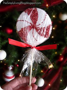 """Peppermint Lollipop (ornaments).  These would be so GREAT for my """"Candy Themed Tree""""   From: http://thesimplylivingblog.blogspot.com/2011/12/peppermint-lollipops.html"""