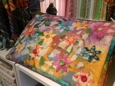 This colourful flower garden hides a really useful and clever embroidery thread storage system, fed up with your thread skeins getting knotted and untidy this will solve all your problems.  Come along and learn lots of techniques in painting and stitching this coming January 2015 at Busy Bees Patchwork, designed and taught by Beccy Paget.
