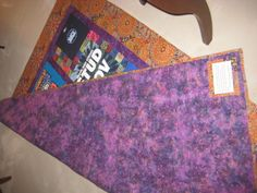 Back of t-shirt quilt. Fun purple batik with personal message from parents.