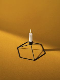POV Candleholder Table is beautiful on itsown, or combine several to create a stunningabstract display on the table.