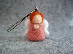 Tiny Angel charm for your phone, handbag or keyring, needle felted in the finest Merino wool.  Hand crafted with love, this angel is approximately 1 tall.  If you would like one of these charms but of a particular colour please contact me.  We are happy to offer combined shipping on multiple purchases, please contact us for this option.  Please note that this is not a toy and is not suitable for young children to play with due to small parts.
