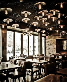 Teqa is a new bar and restaurant in NYC that was designed by Lesly Zamor of Seed NYC. It flaunts an industrial chic feel comprised of raw wood, textured stone, metal, etched antique mirrors, and a custom ceiling treatment made of steel and vintage glass jars that covers the entire lounge.