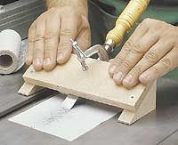 "Sharpening Guide I use sandpaper to sharpen my chisels. By ""sanding"" the bevel of the blade flat and smooth, it produces a sharp edge in just a few minutes. The problem is holding the chisel at a consistent angle as you sharpen. To do this, I clamp the chisel to a simple sharpening guide (see photo). As you can see in the drawing at the right, the guide starts off as a pair of wedge-shaped support blocks that hold the top at a 25° angle. To square up the chisel (and keep it from shif"