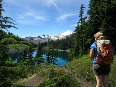Hiker admiring Mount Baker and Iceberg Lake from the Chain Lakes Trail. Photo by Girl and Dog.