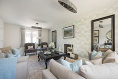 A comfy living room at Orchard Brook with homely interiors. Long Melford, New Homes For Sale, Gallery Wall, Comfy, Interiors, Living Room, Home Decor, Decoration Home, Room Decor