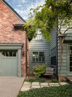 Green Siding With Red Brick Is A Beautiful Pairing Of Color And Texture For A Homes