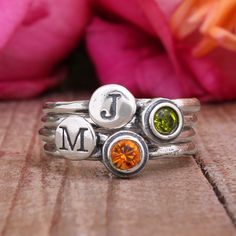 Stackable Mothers Birthstone Rings. Two Stack Initial Rings and Two Stack Birthstone Rings in Sterling Silver by Nelle and Lizzy.    Mix and match!