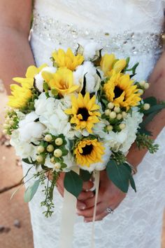 www.blossomartistryweddings.com created this stunning country-chic bridal bouquet with sunflowers, hydrangeas, lilies, and cotton. Let us custom-design one for you!  Photo by www.marthamanning.com
