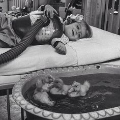 Ducklings used to cheer up girl in a hospital bed, 1956.