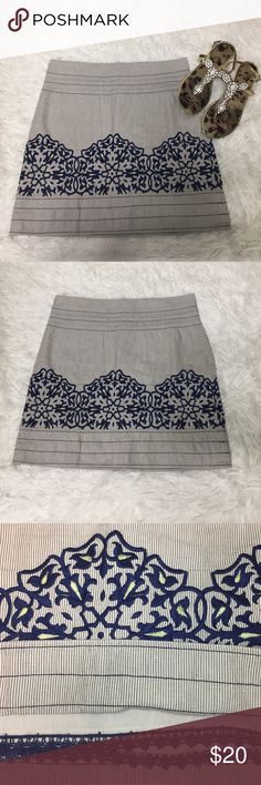 Anthropologie Floreat Pinstriped Embroidered Skirt Anthropologie Floreat Pinstriped Embroidered Skirt Size 2. It is cream colored with navy blue pinstriping and embroidered detail. Fully lined with a zipper in the back. Measures flat waist 15 inches length 17 inches. Anthropologie Skirts