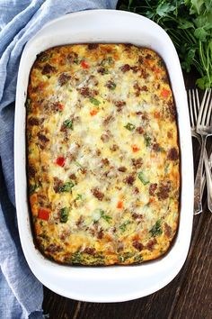 Sausage, Cheese, and Potato Egg Casserole Recipe on twopeasandtheirpod.com This easy breakfast casserole feeds a crowd and can be made in advance. It is perfect for holidays and get togethers.