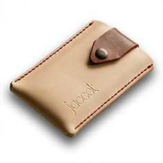 Leather iPhone case. Two tone, natural with saddle tan colored closure. Top quality full-grain leather, sourced at a traditional tannery in Spain.