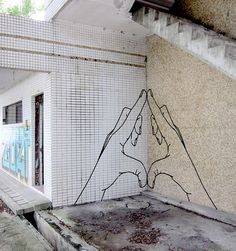 Australian street artist Buff Diss creates works of art out of masking tape. Rather than using spray paint, Buff Diss has chosen to use masking tape as it is nondestructive graffiti that can be removed.