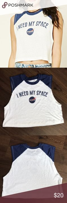 "Urban Outfitters I Need My Space Crop Top Small This is a super cute Crop Top from Urban Outfitters. It has the NASA symbol with I need my space graphic. Size small. Bust 38"" length 17"". Mint condition. Urban Outfitters Tops Crop Tops"
