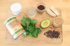 3 Smoothies To Boost Your Mood & Energy      1 frozen banana     1 handful of spinach      1/2 avocado     2 tablespoons nut butter     1 teaspoon vanilla     1 cup almond milk     1/2 cup coconut water     1 tablespoon Superfood Greens      3 tablespoons raw cacao nibs