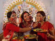 """According to a popular belief, goddess Durga returns to her mother Menoka and father Giriraj during puja. Arriving with her sons Kartik and Ganesh, daughters Lakshmi and Saraswati, and two friends Jaya and Bijoya, Durga stays with her parents for four days, only to return to Shivalaya on 'dashami'. """"After bidding her farewell, the women play with sindur and pray for their long and happy married lives,"""""""