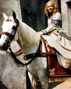 Ingrid Pitt riding her horse on the castle set of  'Countess Dracula', 1971