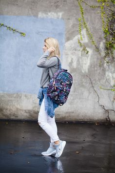 542f281b0ea8c White distressed jeans paired with PUMA Fierce sneakers and bright backpack.