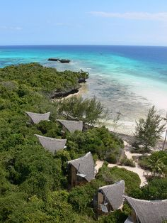 Reclusive beach huts on Chumbe Island, Tanzania. The island (off the coast of Zanzibar) is a private reserve using sustainable energy technology.