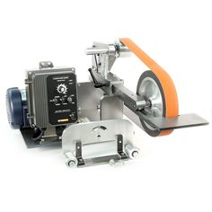 """Variable Speed KMG-10 Package includes:      KMG-10 Grinder with  10"""" contact wheel.     Platen attachment.     Work rest.     2 hp variable speed motor and VFD, or optional 3 hp motor and VFD.     Pulley for motor.     Pulley for grinder.     Drive belt.     Base plate.     Mounting bracket for VFD and electrical hardware.     Uses 2"""" X 72"""" belts.  *The 2 hp motor and VFD will run on standard 110 or 220VAC.    $2,028.50 usd"""