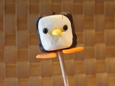 """This penguin can also be used as a cupcake or cake decoration! It's a fun project to do with kids. Clicking on the image will take you to the tutorial which is on my YouTube channel """"SparkedIdeas""""."""