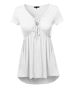 Gathered fabric under the bust adds flattering shape to this draping tunic. A lace-up detail at the neckline frames your face with casual allure. Size note: This item runs small. Ordering one size up is recommended.