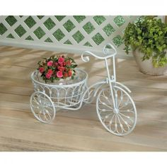 Display it indoors or outside. Old world charm will bloom anywhere this three-wheeled bicycle goes. Old Fashioned Bicycle Plant Stand. Holds up to a flower pot. Garden Plant Stand, Garden Planters, Planter Pots, Garden Beds, Wheelbarrow Planter, Indoor Garden, Garden In The Woods, Home And Garden, Plant Stand With Wheels