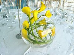 Low centerpieces surrounded by floating candles. We'd use white calla lilies Yellow Flower Arrangements, Yellow Centerpieces, Calla Lillies, Calla Lily, Wedding Table Decorations, Wedding Centerpieces, Submerged Flowers, Mellow Yellow, Wedding Flowers