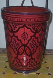 Safi Red Pot - $28.00   Treasures of Morocco is proud to have available this heavy and durable, handcrafted and hand painted flowerpot imported from Morocco. Decorated with pleasing and distinctive colors. it's ready to be displayed on your patio, porch or wherever you desire and have one hole in the bottom  for drainage.  https://treasuresofmorocco.com/shop/?slug=product_info.php&products_id=539
