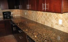Baltic brown granite countertops with light tan  backsplash...would look good with my light cabinets.