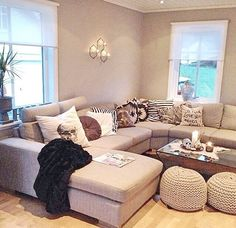 neutral palette, jazzy cushions and bohemian floor cushions = perfection