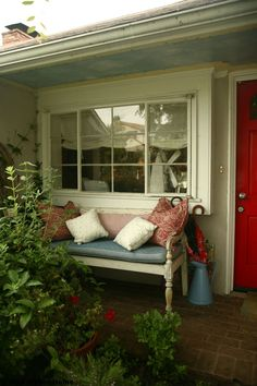 From Well styled Home: All you need to create a welcoming spot on the porch is room for two to sit and chat. This small porch spans just 3-by 8-feet but by adding a narrow padded bench, a few colorful throw pillows and tiny table at one end for a few garden accessories, it feels welcoming and special. For an added touch of charm, consider painting the roof like this homeowner did; it lightens up the dark overhang and adds a fun unexpected surprise. Photo by Jaimee Itagaki.