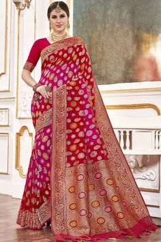 Red And Pink viscose saree with red viscose blouse. Embellished with woven zari work. Saree with V Neck, Half Sleeve. It comes with unstitch blouse, it can be stitched to 32 to 58 sizes. #weddingsaree #weddingwearsaree #festivalwear #partywearsaree