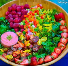 Chris and I love this salad. Its pretty What we put in it: 3 Strawberries, handful raspberries, 3 baby tricolor bell peppers,  handful heirloom tomatoes, spinach, 1/2 cucumbers and  I buy a raspberry vinaigrette dressing