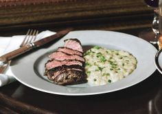 "Beef Tenderloin Medallions with Potato ""Risotto"" by Bon Appetit Magazine. Potatoes are finely cut into smallcubes, then cooked risotto-style."