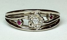 18ct white gold, diamond and ruby ring in the form of a flower