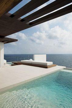 infinity pool with minimal furniture
