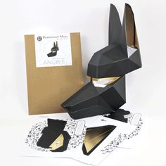 Buy this Anubis papercraft mask PRE-CUT KIT and save a lot of time and effort. It contains the 10 pieces of the mask pre-cut and scored for your convenience. Paper Glue, Paper Crafts, 3d Paper, Paper Quilling, Low Poly, Mask Paper, Egyptian Mask, Egyptian Costume, Anubis And Horus