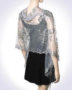 Product No.: 2942  http://www.yourselegantly.com/stunning-silver-evening-wrap.html Buy this Stunning Silver Evening Wrap on sale and look elegant and beautiful. Women's evening shawls on sale at deep discounts. This Silver Sequins Formal Dressy Evening Shawl is a gorgeous dressy party wrap. This Formal Designer Evening Wrap is beautiful in style, embellished design and beauty.