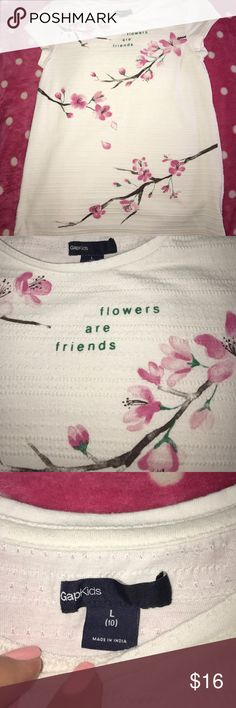 NWOT GapKids ivory t with pink flowers Brand new and never washed or worn but tags removed. From Gap, size Large. Short sleeves with pink flowers, beautifully detailed. GAP Shirts & Tops Tees - Short Sleeve