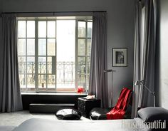 Designer David Mann chose a shimmery gray, silver, and black color scheme for this sexy, contemporary bedroom in New York. For brightness, the owner simply pulls back the floor-length curtains to reveal an expansive balcony.   - HarpersBAZAAR.com