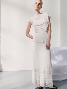 Tabby Dress | Ultra femme sheer mesh maxi dress inspired by decades past with romantic ruffles, cute crochet and lovely lace accents throughout.      * Lined with separate slip featuring adjustable straps  * Hidden back zipper closure  * Hidden elastic band at the waist